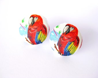 Fabric covered button earrings with a red parrot pattern