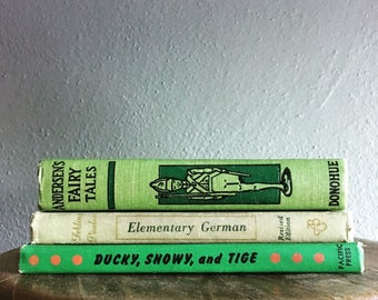 Set of three vintage green books