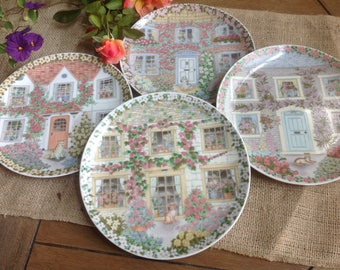 Adorable Cottage House Plates with Cats and Dogs Pastel Houses and Flower upon Flower Each with its own Floral Border