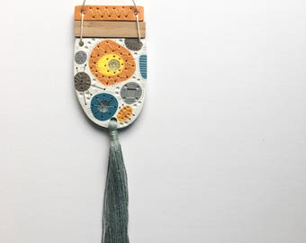 WEIRDLINGS polymer clay wall hanging teal yellow blue grey