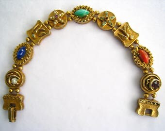 """Victorian Revival Bracelet.  9 Gold Links with Raised Designs including Birds & Stars, Cabochons, Rhinestones, Pearls. Gold Tone.  7.5"""""""