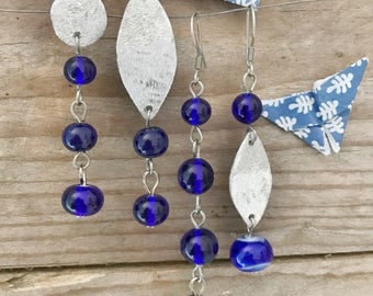 set of four blue earrings with handblown glass beads