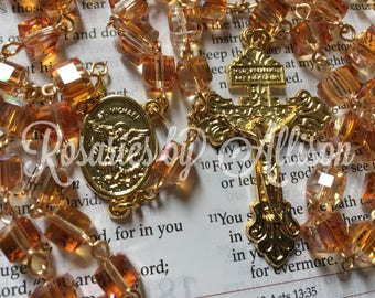 Crystal Copper crystal cube bead rosary w/ gold plated St Michael center and pardon crucifix