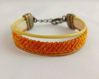 Variegated orange and yellow bracelet created with a vintage, silk kumihimo haori tie