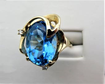 14K Solid yellow Gold Blue Topaz and Diamonds Ring Size 7, weight 9.8 Grams