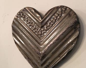 Ornate distressed light taupe/gray  heart designed with antique tin ceiling tile