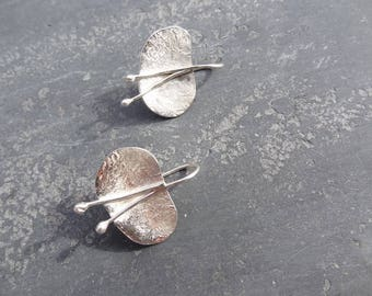 Forged sterling silver stud earrings.