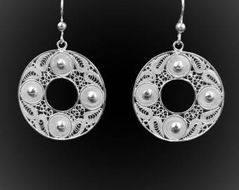 Compass earrings in silver embroidery