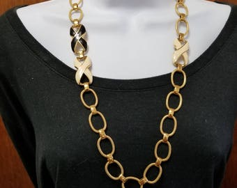 Vintage Monet linked necklace with gold tone metal and enamel