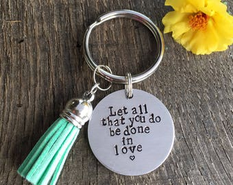 Let all that you do be done in love hand stamped keychain with tassel