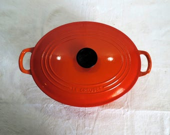 Le Creuset size 31 casserole or Dutch oven in retro orange changing to red at the base