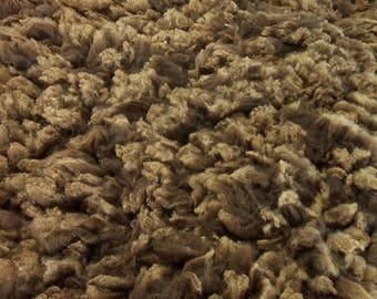 Ember's 4 pound Corriedale x Australian Bond raw fleece