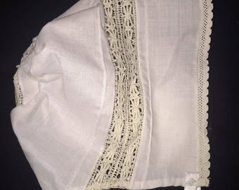 Rows of Heirloom French lace insertion on a baby bonnet or hat, Christening, Dedication with Swiss batiste fabric