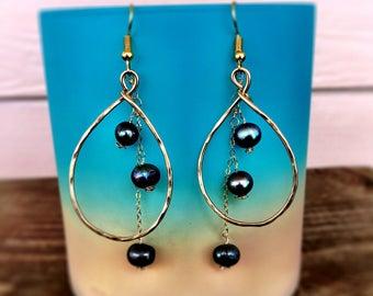 Triple pearl teardrop earrings...