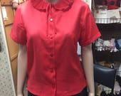 Red blouse witth frilly c...