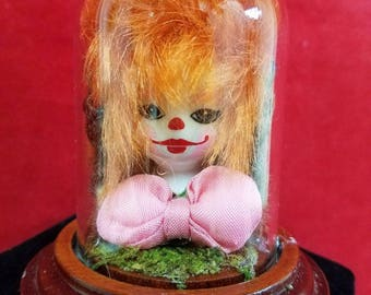 Taxidermy Squirrel Paw(s) holding Clown Head Glass Dome Display-creepy macabre
