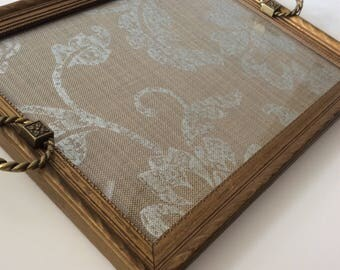 Upcycled vintage gold rectangular frame tray with vintage ring handles and silver and taupe floral upholstery fabric