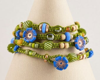 4 -Strand Macrame Wrapped Bracelet- (Periwinkle Flower Buttons- Chez Glass Beads- Horn Beads- Crystal Beads- Glass Beads)
