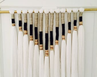 Yarn wrapped wallhangings on brass