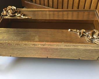 Vintage Stylebuilt gold footed tissue holder with rose appliqué details