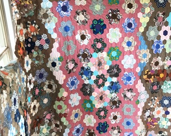 A lovely unused incomplete vintage hexagonal patchwork quilt