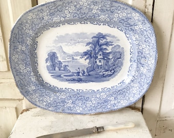 a beautiful antique blue and white transfer roast platter