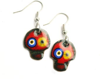 Red skull dangly earrings. Enamel jewelry by Katherine Reekie.