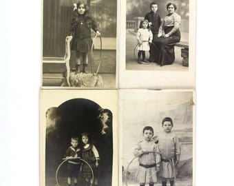 Antique photos of boys and girls (ca. 1910s) with a hoop. Set of 4 French RPPC.