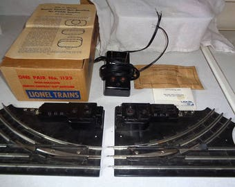 Lionel electric trains,Boxed  027 gauge remote control  track switches  nice shape,tested and working