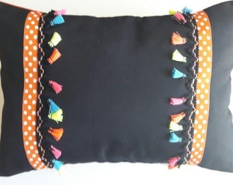 CUSHION RECTANGLE trimmed black tassels