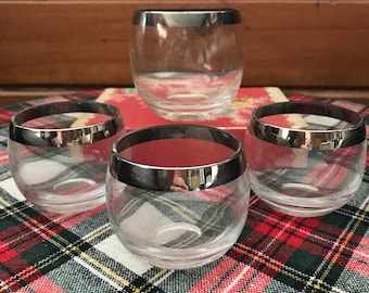 Vintage set of 3 small roly poly glasses and one average size. All four are silver rimmed Dorothy Thorpe style glasses.