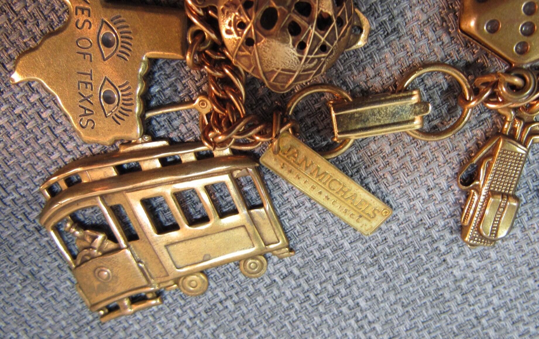 jan michaels of san francisco retired art deco usa traveler antique bronze charm bracelet amazing. Black Bedroom Furniture Sets. Home Design Ideas