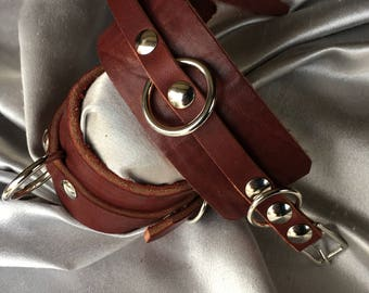 Wrist cuffs smaller in sizes, featuring a smaller buckle but still a wide wrist leather   Latigo leather.