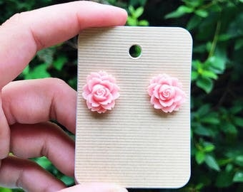Pink resin flower earrings, with surgical steel posts
