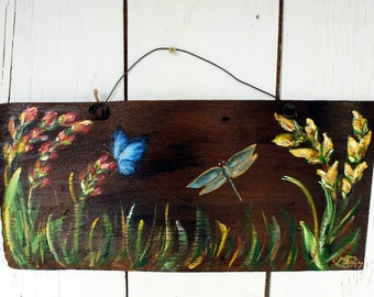 Flowers, a butterfly and a dragonfly on a cedar shingle, rustic