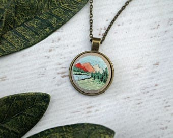 Hand Embroidered Necklace Pendant - Pastel Pink Landscape Mountain Scene on Cotton Fabric Pink - Antiqued Bronze Gold