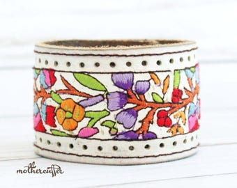 CUSTOM HANDSTAMPED wide white leather cuff with flower design and stitching by mothercuffer