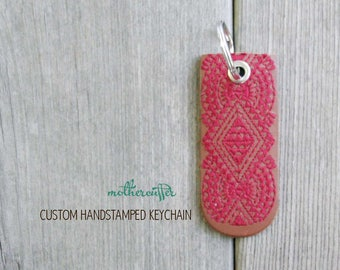 CUSTOM HANDSTAMPED brown leather keychain with red stitching by mothercuffer