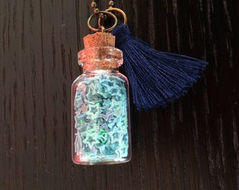"""Series """"Vial"""" 3: pendant with small glass phial with star charm and flashy"""