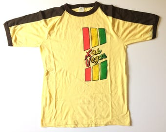 Vtg. LAS VEGAS SHRINKAGE Controlled 50/50 Blend T-Shirt / Yellow and Brown / Size Small