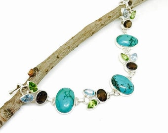 10% Turquoise ,peridot, smokey quartz, blue topaz multigemstone bracelet set in sterling silver 925. Natural authentic stones. Adjustable le