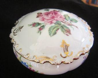 GDA France Porcelain Vanity Powder Trinket Bowl- pink rose in lid center. Gold-leaf on ornate scalloped edges. Floral sprigs on side. Gift
