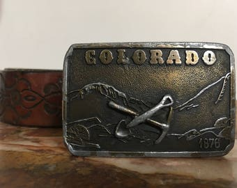 Vinage hand tooled leather belt with removable vintage Colorado brass buckle