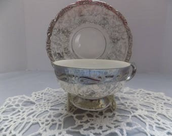Silver and White Footed Teacup and Saucer with Crown Makers Mark