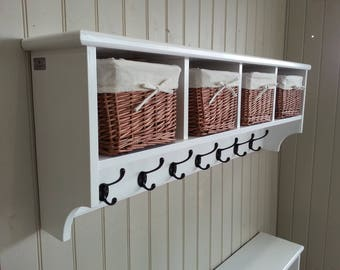 Hat & coat rack with shelf including storage baskets compartments and cubby holes. Painted wood wall mounted display shelves cast iron hooks