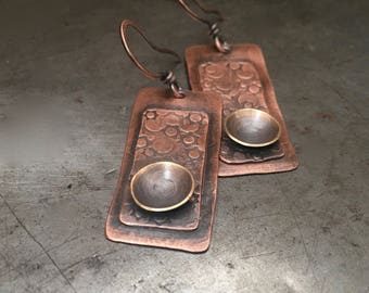 Rustic mixed metal earrings, textured copper layered celestial design with antique brass cup
