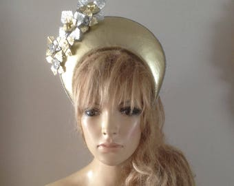 gold leather crown hat adorned with hand sculptured silver & gold leather flowers
