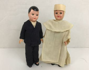 Celluloid dolls Nun in White habit and Priest