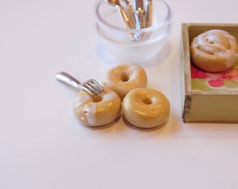 Set of Three Dollhouse Miniature Doughnuts With Golden and White Frosting