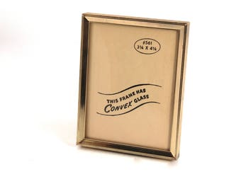 Vintage 3x4 picture frame - gold-tone, empty, metal, table stand, school picture frame, convex glass, mid century, small